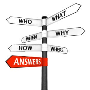 Crossroads sign with questions in every direction and answers pointer highlighted in red